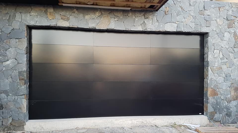 Designer sectional garage door for a Warana house.