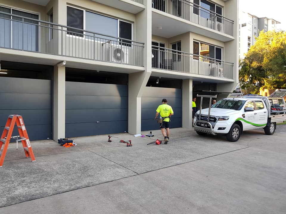 ten tilt garage doors installed at an apartment complex in Caloundra, Sunshine Coast.