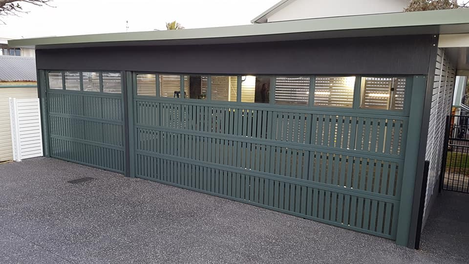 Designer automated garage doors installed for a client.